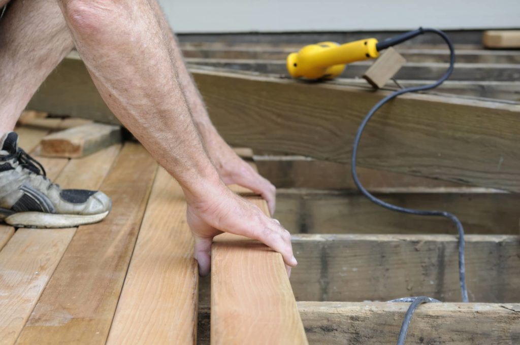 This is an image showing deck installation by a professional.